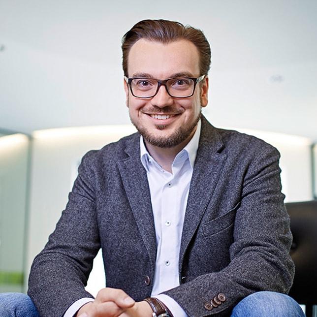 Michael Sahlender sitting smiling - CELUM headquarters
